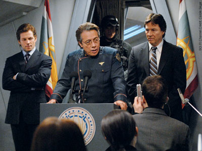 Adama, flanked by Apollo and Tom Zarek in Battlestar Galactica