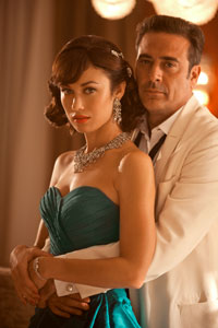 "Olga Kurylenko and Jeffrey Dean Morgan in ""Magic City"""