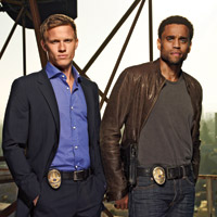 Warren Kole as Wes, Michael Ealy as Travis