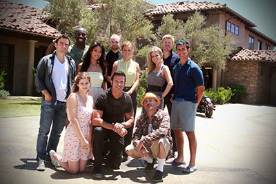"The cast of ""The Joe Schmo Show"" (left to right): back row standing: ""Allan,"" played by Rob Belushi; ""Lavernius,"" played by Segun Oduolowu; ""Allison,"" played by Nikki McKenzie; ""Stan,"" played by Fred Cross; ""Karlee,"" played by Joanna Newman; ""Chloe,"" played by Chelsey Crisp; ""Randy,"" played by Michael Weaver; and Rogan. Front row, (kneeling left to right): ""Skylar,"" played by Meghan Falcone; Lorenzo Lamas, as himself; and ""Chico,"" played by Lombardo Boyar. ""The Joe Schmo Show"" premieres on Spike"