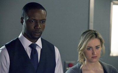 """BLINDSPOT -- """"Of Whose Uneasy Route"""" Episode 121 -- Pictured: (l-r) Rob Brown as Edgar Reade, Ashley Johnson as Patterson -- (Photo by: Paul Sarkis/NBC)"""