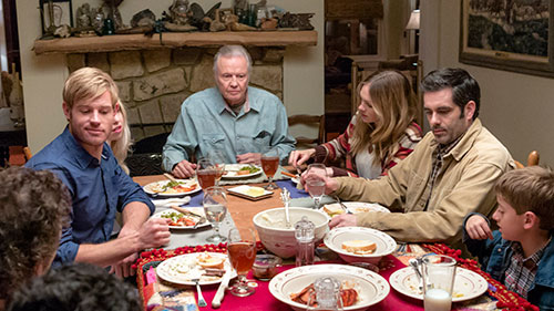 Trevor Donovan and Abby Brammell sit down with Jon Voight, showing the family atmosphere evident throughout the film.