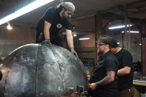 "From Left, Miles, Kent and Oscar work on a Death Star fire pit in the premiere episode of ""Milwaukee Blacksmith."""