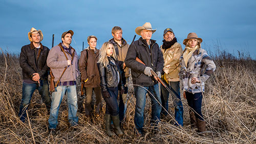 Some of the star-studded cast members — including Jon Voight, Teri Polo and Trevor Donovan — pose as they ban together to protect the Landsburg Ranch.